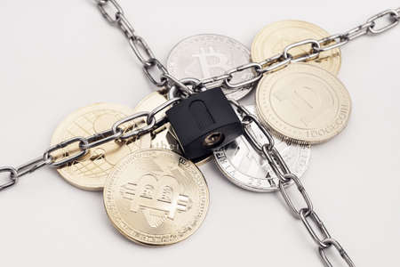 Cryptocurrency security concept. Group of crypto coin protected by chain and padlock