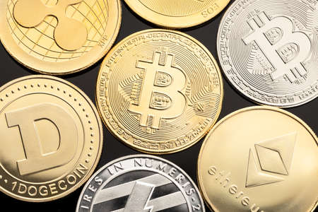 group of cryptocurrency coin on black background. Bitcoin, dogecoin, ethereum, xrp, eos, litecoin blockchain money. Top view