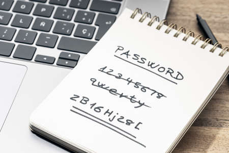Strong and weak easy Password concept. Handwritten text on notepad on laptop