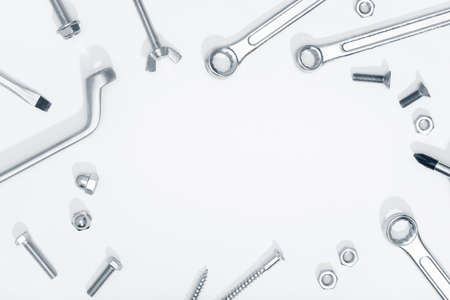 Border frame of Tool, screw and nut on white background. Copy space. Labor day concept
