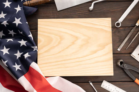 Top view of american flag , work tools and blank wooden plank for text. Template Mock up. Labor day concept background