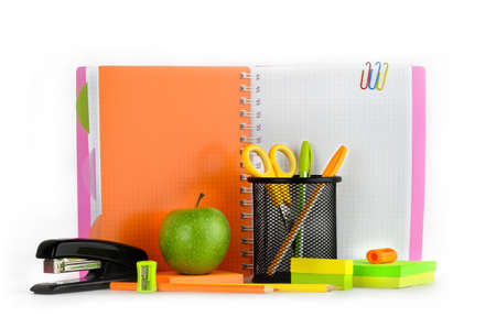 Colored stationery with green apple on the background of notebook Stock Photo - 19530941