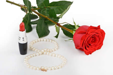 Roses, pearls and red lipstick on a light background Stock Photo - 19530939