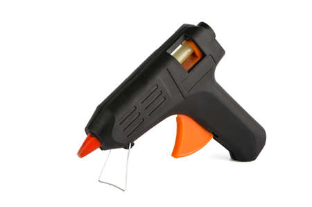 affix: Black glue-gun closeup on a white background Stock Photo