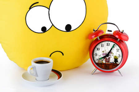 Big yellow smile, a cup of coffee and an alarm clock photo