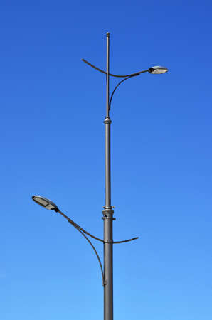 High street lamp with LEDs on the background of blue sky photo