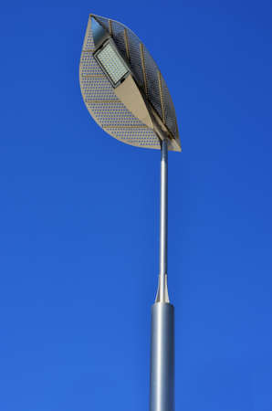 outdoor lighting: LED street lamp in the form of petals on a background of blue sky Stock Photo