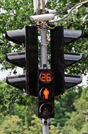 Red traffic light on a city street photo