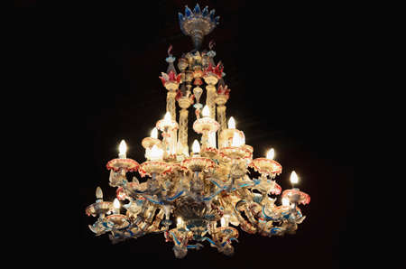 Old, large, colored, glass chandelier photo