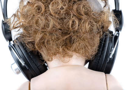 Back of the head with headphones closeup photo