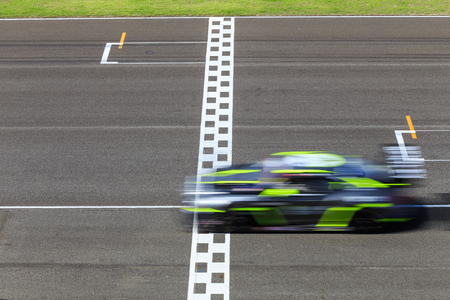 Race car crossing the finish line on a circuit