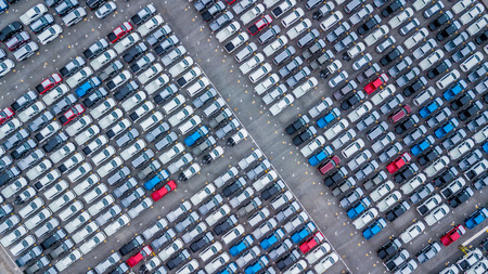 Aerial view new cars lined up in the port for import and export, Top view of new cars lined up outside an automobile factory for import & Export. Imagens