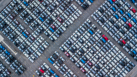Aerial view new cars lined up in the port for import and export, Top view of new cars lined up outside an automobile factory for import & Export. Banco de Imagens