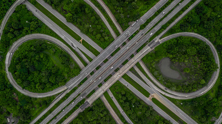 Aerial view highway junction, cross roads, interchange and expressway is an important infrastructure in Thailand.