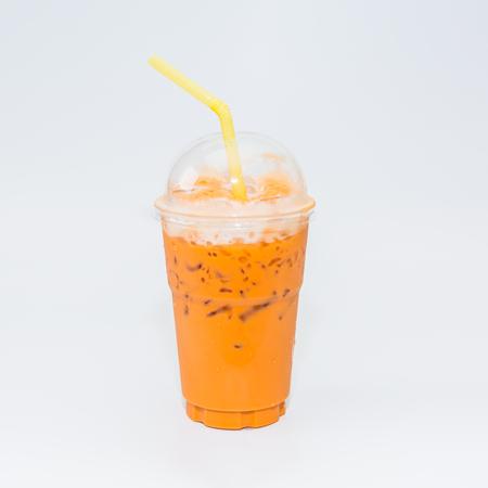 Thai tea in plastic glass on white background, Iced milk tea or Thai milk tea on white background.
