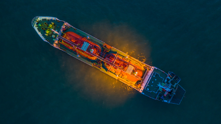 Aerial view oil / chemical tanker in open sea at night, Refinery Industry cargo ship.