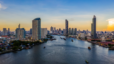 Bangkok city skyline and skyscraper with business building in Bangkok downtown, Chao Phraya River, Bangkok, Thailand. Stock Photo