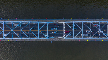 Aerial view on traffic bridge over river, cars on bridge Stock Photo