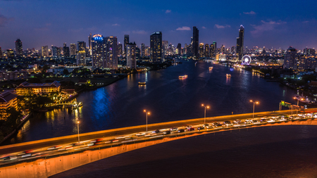 Aerial view Bangkok city skyline and skyscraper at night with business building in Bangkok downtown, Chao Phraya River, Bangkok, Thailand.