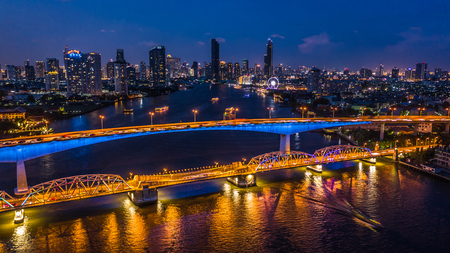 Aerial view Bangkok city skyline and skyscraper at night with business building in Bangkok downtown, Chao Phraya River, Bangkok, Thailand.