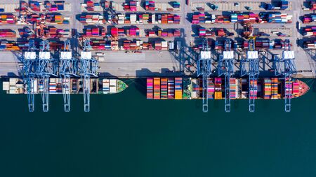 Aerial view container cargo ship freight shipping unloading at original destination port with quay crane, Business commercial global oversea logistic import export container box by container vessel .
