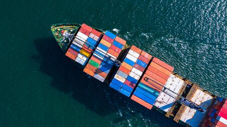 Aerial view container ship carrying container box global business cargo freight shipping commercial trade logistic and transportation oversea worldwide  by container vessel.Container cargo freight ship.