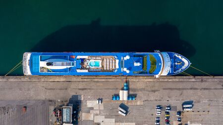 Aerial view cruise ship parking the pier, Cruise ship at harbor. Aerial view beautiful large white ship, Top view from drone of luxury cruise ship floating liner, Covid-19 check.