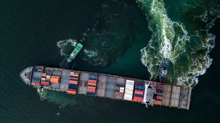 Container cargo ship with tugboat in the ocean, Business global commercial trade container box freight shipping import export logistic transportation oversea by container vessel worldwide.