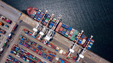 Container ship loading and unloading in deep sea port, Aerial view of business logistic import and export freight transportation by container ship in open sea, Container loading Cargo freight ship. Stock Photo