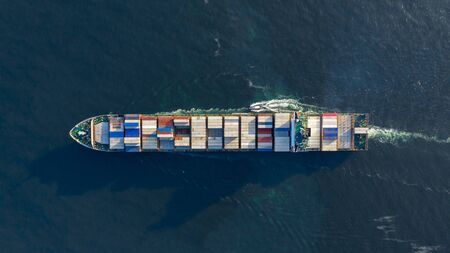 Aerial view container cargo ship, Global business import export commerce trade logistic and transportation worldwide by container cargo ship boat in the open sea, Freight shipping maritime vessel.