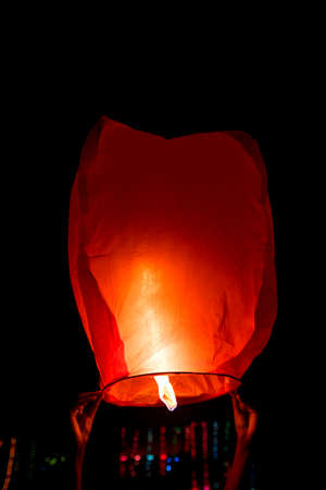 sky lantern, also known as Kongming lantern or Chinese lantern in black sky