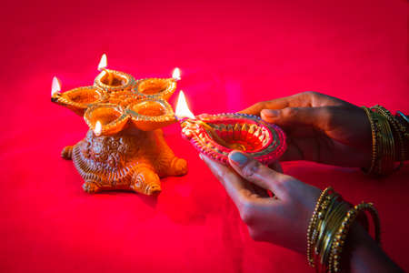 Colorful clay diya lamps lit during diwali celebration