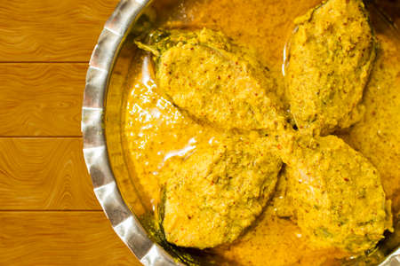 popular Bengali Illish/Hilsa fish curry with grinned mustard seed.