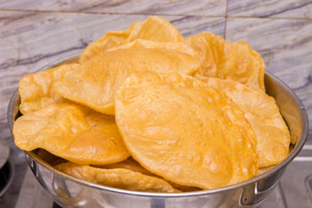 popular Indian fast food puri made of corn flour fried with vegetable oil