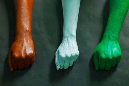 three hands are painted with three colors,saffron,white and green to represent tricolor Indian national flag.15 August Independence day India.celebration of freedom.symbol of brotherhood. Banco de Imagens