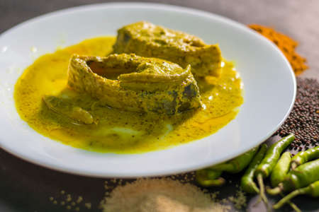 Famous Bengali Dish Hilsa/Ilish fish with poppy and mustard seed recipe.
