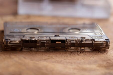 A Vintage Cassette Tape on a Rustic Wooden Surface. Standard-Bild - 133704831