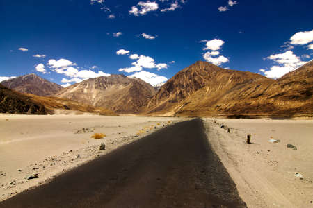 Road between Nubra Valley and Khardungla Ladakh through the desets and sand dunes Stock Photo - 10322736