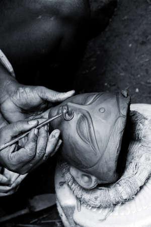 CALCUTTA - August 15: An artisan creates clay head of goddess Durga on August 15, 2011 in Kumartuli, Calcutta, India. The idols are made for the Hindu festival of Durga Puja also known as Dassera