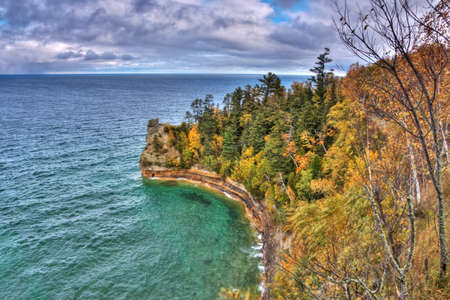 pictured: Pictured Rocks in Fall Colors of Upper Peninsula MIchigan Usa