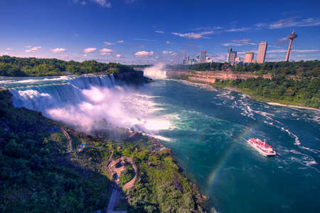 the edge of horseshoe falls: Niagara Falls And American Falls with Rainbow, New York, USA Editorial