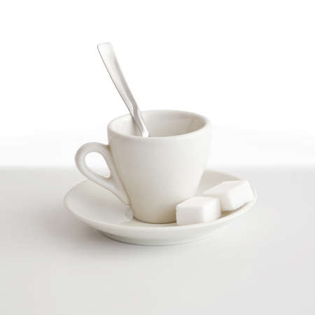 A coffee cup with saucer, teaspoon and sugar Stock Photo