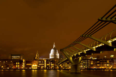 Cathedral of St Paul and Millennium Bridge in London Editorial