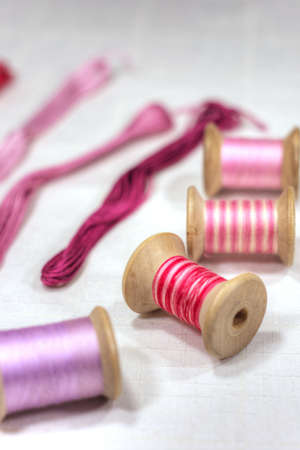 Spools and cotton threads for embroidery Stock Photo