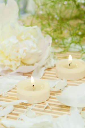 spa candles with peony petals photo
