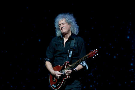 MINSK, BELARUS - MARCH 21, 2014  Brian May from Queen performs with Kerry Elils during  Acoustic by Candlelight Tour  Редакционное