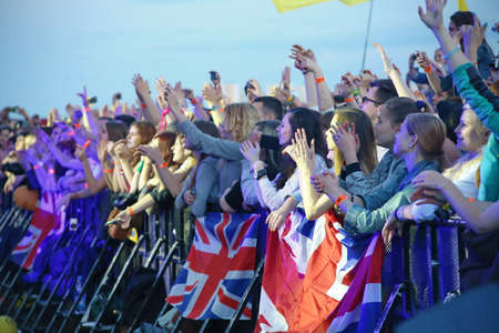 british people: MINSK, BELARUS - JULY 03: People crowd with british flags during Most festival on July 3, 2014 in Milnsk, Belarus.