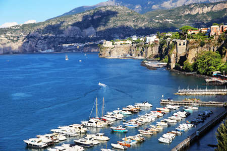 SORRENTO, ITALY - OCTOBER 9, 2016: White yachts and ships of different sizes in sunny summer day