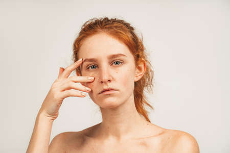 Close up face natural beauty redhead attractive woman with freckles. Isolated over white background. Natural beauty and health