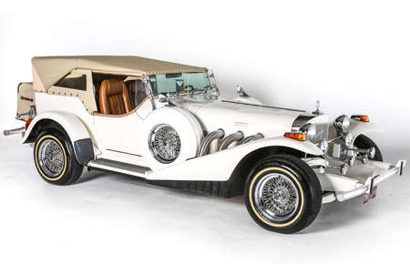 white car: Studebaker Excalibur classic open wheel motorcar car isolated white background
